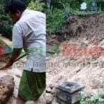 Warga membersihkan material longsor dan mengembalikan batu nisa (Foto. Facebook Helmah Ali)